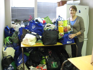 Diane readies the Christmas Gift Bags for distribution