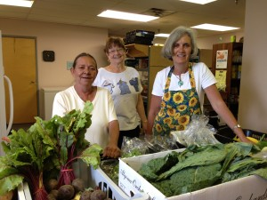 Volunteers and fresh produce in the Food Pantry